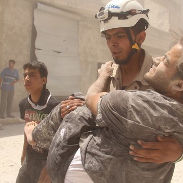 Saving a young guy after many barrel bombs targeted the city of Aleppo