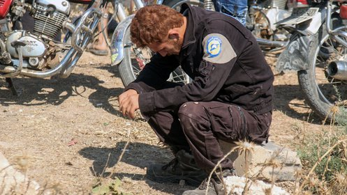 A volunteer mourns the loss of his 7 fellow volunteers killed in a single attack